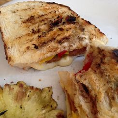 Decadent  spicy sausage and pepper sandwich