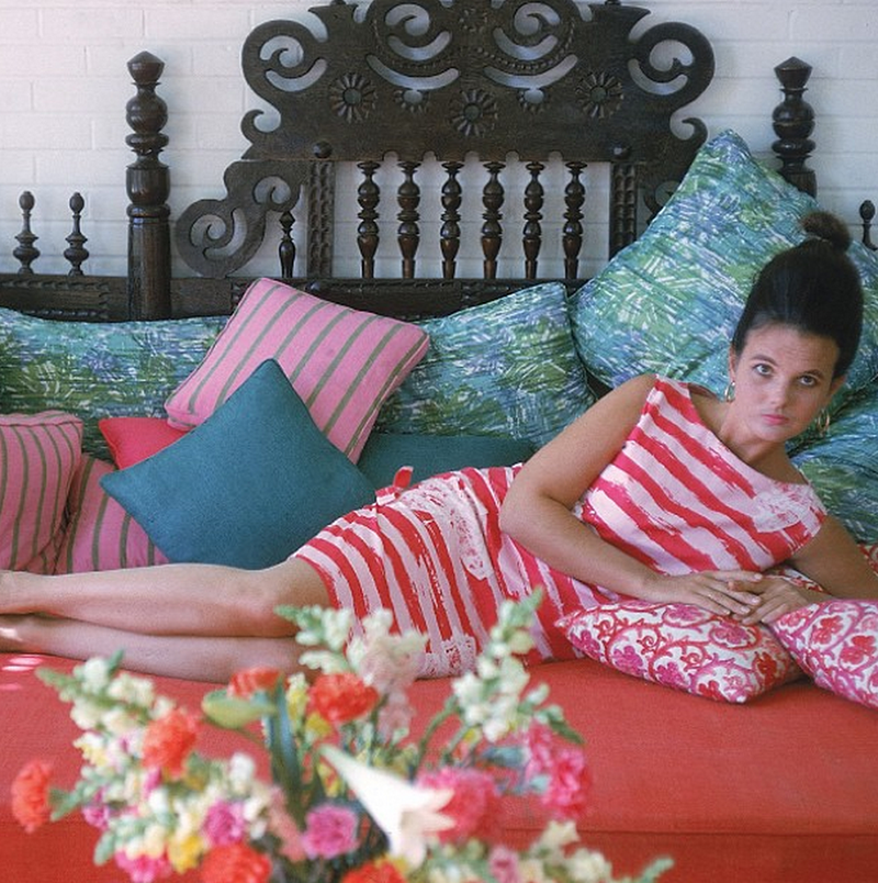A young Lilly Pulitzer lounging in one of her designs.