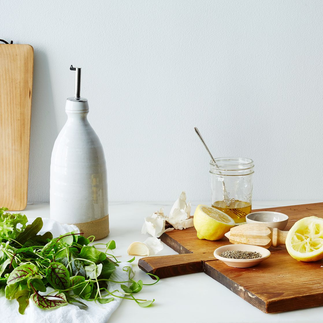 olive oil cruet on food - olive oil cruet