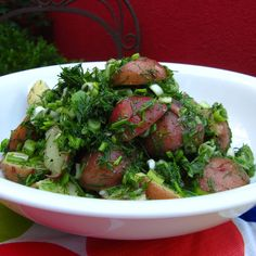 Potato salad with cider vinegar, dill and scallions