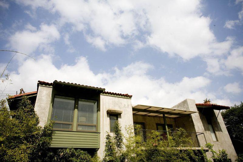 The Hotel San José against an Austin sky.