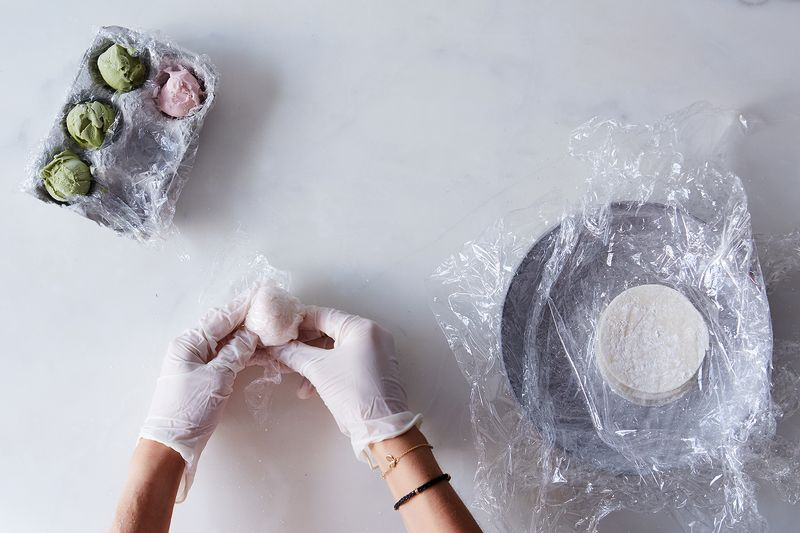 Plastic wrap helps to hold everything in until the ice cream has a chance to re-freeze.