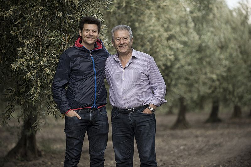 Michele and his father in their grove in Puglia.